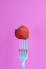 One strawberry on a fork, pop art
