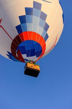 Colorful hot air balloon on the background blue sky.