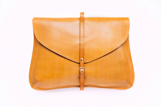 Woman yellow purse isolated on the white background. Closeup of modern yellow leather wallet over white background. Top view on the wallet.