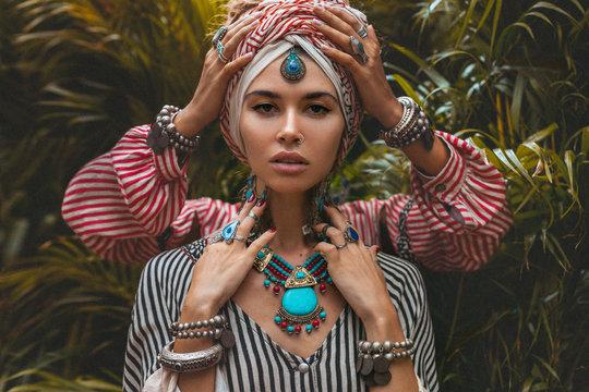 portrait of two beautiful stylish woman wearing turban