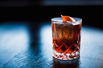 Negroni cocktail on dark stone table. With space for your text