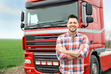 Portrait of driver at modern truck outdoors Wall mural