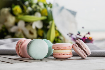 Close up colorful macarons dessert with vintage pastel tones