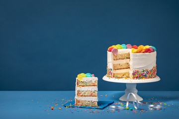 Colorful Birthday Cake with Slice and Sprinkles