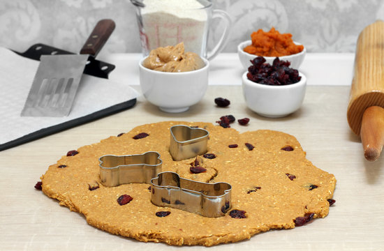 Baking peanut butter,pumpkin, oat and cranberry dog biscuits.
