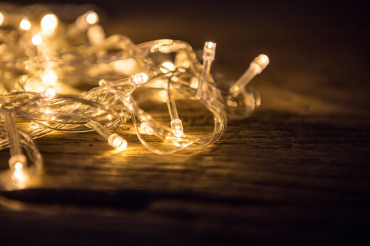 Close up of beautiful LED warm lights on wooden floor