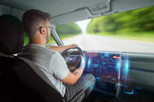 A man in an autonomous car. Self-driving. Concept autopilot, automotive engineering, artificial intelligence