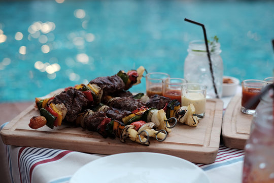 Barbecue party near pool