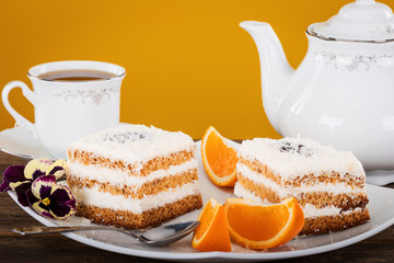 delicious tea with delicious pastries, orange and flowers