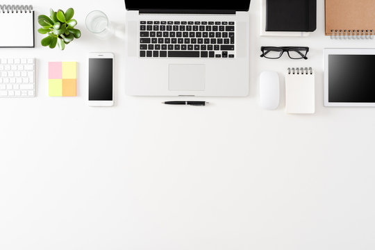 Modern office desktop with laptop and accessories
