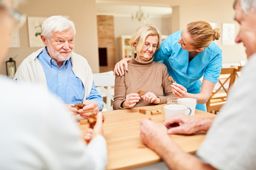 Caregiver cares for a senior woman with dementia