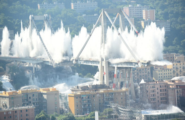 Controlled explosions demolish two of the pylons of the Morandi bridge almost one year since a section of the viaduct collapsed killing 43 people, in Genoa