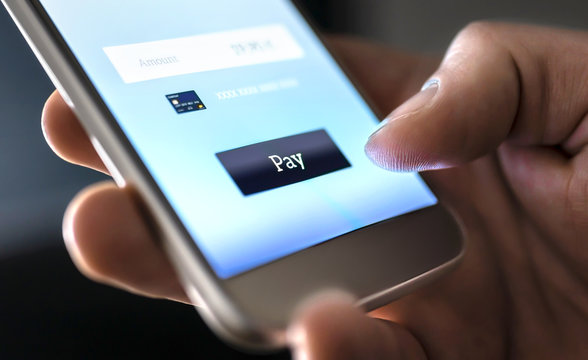 Mobile payment with wallet app and wireless nfc technology. Man paying and shopping with smartphone application and credit card information. Digital money transfer, banking and e commerce concept.