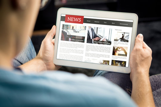 Online news article on tablet screen. Electronic newspaper or magazine. Latest daily press and media. Mockup of digital portal and website. Happy person using web service in the morning. Reading text.