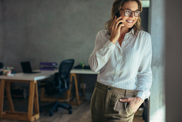 Relaxed businesswoman talking on cell phone