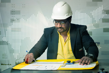 Architect drawing blueprint in the office
