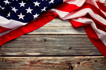 American flag on old rustic wooden board