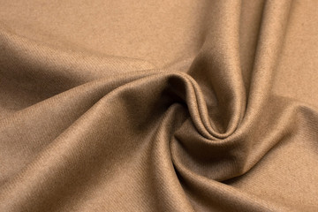 Wool fabric. Color beige. Texture, background, pattern.