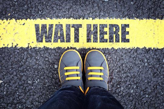 Wait here feet behind waiting line