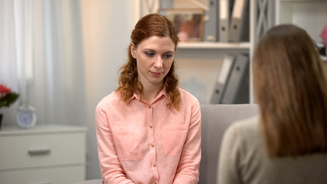 Pensive female feeling guilty, psychological counseling session, mental health
