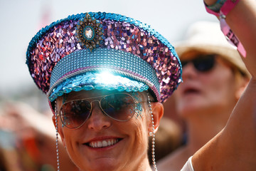 A festival goer wears a sequin covered hat in the crowd for the Pyramid Stage during Glastonbury Festival in Somerset