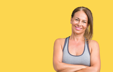 Wall Mural - Beautiful middle age woman wearing sport clothes over isolated background happy face smiling with crossed arms looking at the camera. Positive person.