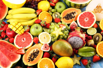 Tropical fruits background, many colorful ripe fresh tropical fruits Wall mural