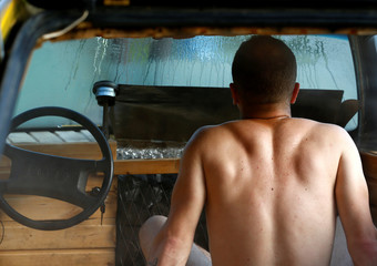 Liiv cleans enjoys a sauna in an old yellow Audi car converted into a small sauna in Tallinn