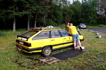 Inventor and owner Maesalu prepares his old yellow Audi car converted into a small sauna in Tallinn