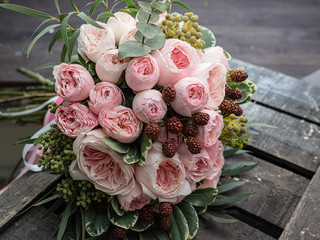 Beautiful wedding bouquet of shrub and peony gently pink roses. Fotobehang