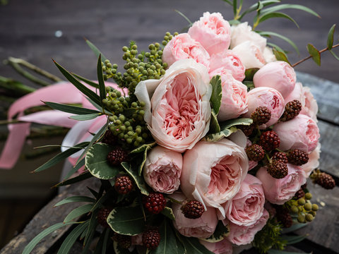Beautiful wedding bouquet of shrub and peony gently pink roses.