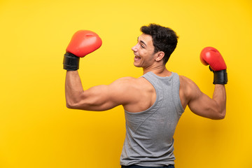 Handsome sport man over isolated background with boxing gloves