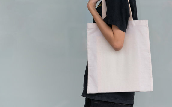 woman carry bag on nature background in save earth concept or say no plastic bag.