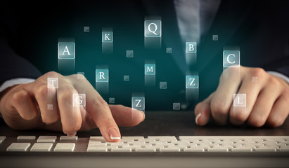 Business woman typing on keyboard with letters around  Wall mural