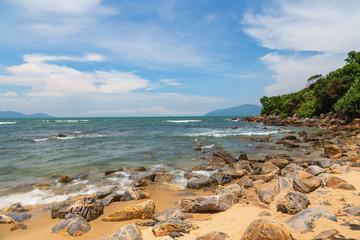 Exotic tropical beach under blue sky.