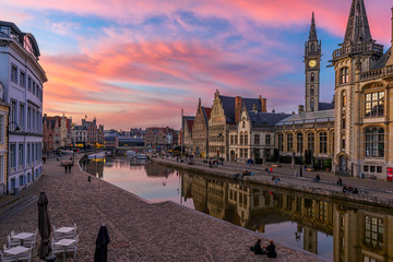 Wall Mural - View of Graslei, Korenlei quays and Leie river in the historic city center in Ghent (Gent), Belgium. Architecture and landmark of Ghent. Sunset cityscape of Ghent.