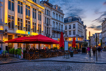 Wall Mural - Old street with tables of cafe in center of Brussels, Belgium. Night cityscape of Brussels (Bruxelles). Architecture and landmarks of Brussels.