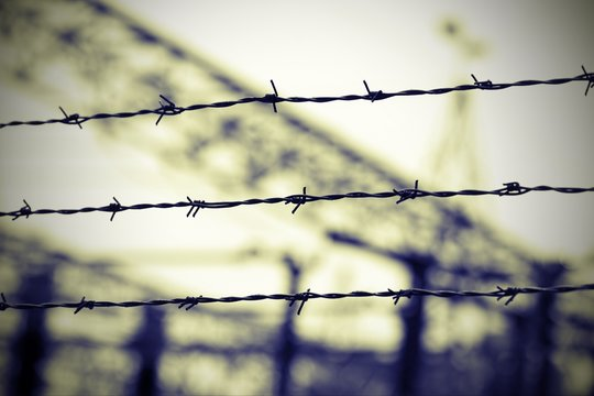 barbed wire in the concentration camp  and the background blurre