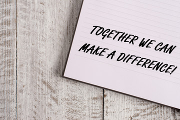 Conceptual hand writing showing Together We Can Make A Difference. Concept meaning be very important some way in like team or group Notebook stationary placed above classic wooden backdrop