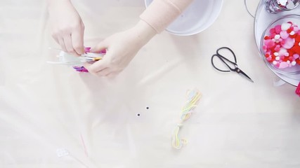 Wall Mural - Flat lay. Step by step. Mother and daughter making unicorn craft from paper foam.