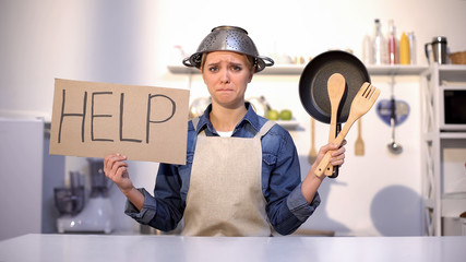 Inexperienced housewife asking for help in cooking, wearing pot on head, joke