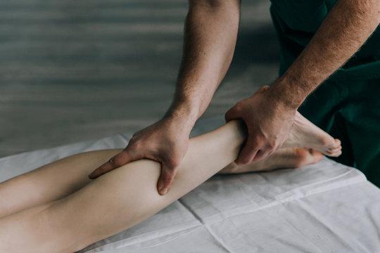 Foot calf massage. Lymphatic drainage massage.