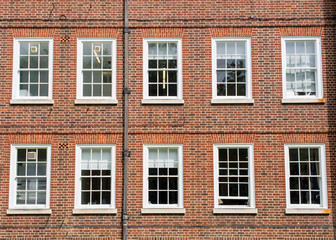 Eight windows with white sash and frame on a red brick wall Georgian British style Wall mural