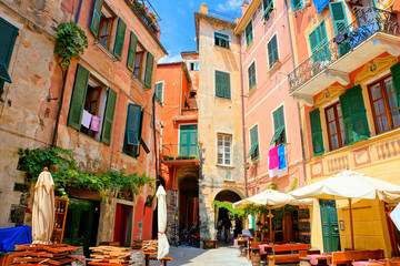 Fototapete - Colorful square with restaurant tables in the Cinque Terre village of Monterosso, Italy