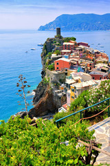 Wall Mural - Beautiful Cinque Terre village of Vernazza, Italy. Aerial view overlooking the town and the blue sea.