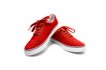 A pair of red canvas shoes isolated on white