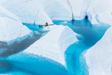 Wall Mural - Paddling behind an iceberg looking fin of ice on the Matanuska Glacier in Alaska