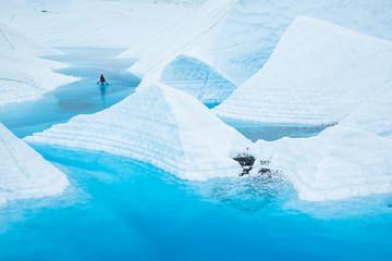 Wall Mural - Canoe paddling across massive glacier lake in Alaskan wilderness