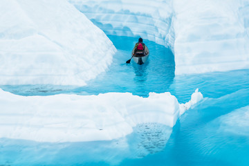 Wall Mural - On top of a glacier is a dangerous place to paddle a canoe, but also a beautiful place to see from a new angle.