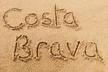 Costa Brava handwritten beach sand message